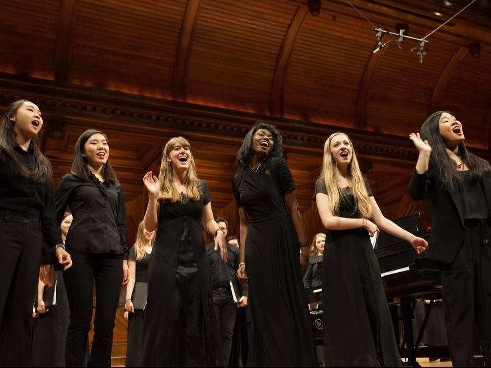 'Cliffe Notes singers performing on the Sanders Theatre stage.